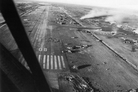 Port Stanley airfield at the end of the conflict. The scars from the Vulcan Black Buck and Harrier and Sea Harrier bombing raids are visible. (Crown Copyright)
